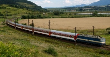 Summer view of fast train going through Slovak region of Liptov, near Besenova village.