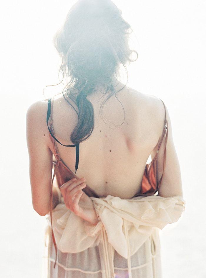 These soft, warm tones have a nostalgic feel.   #engagementphotos #boudoir