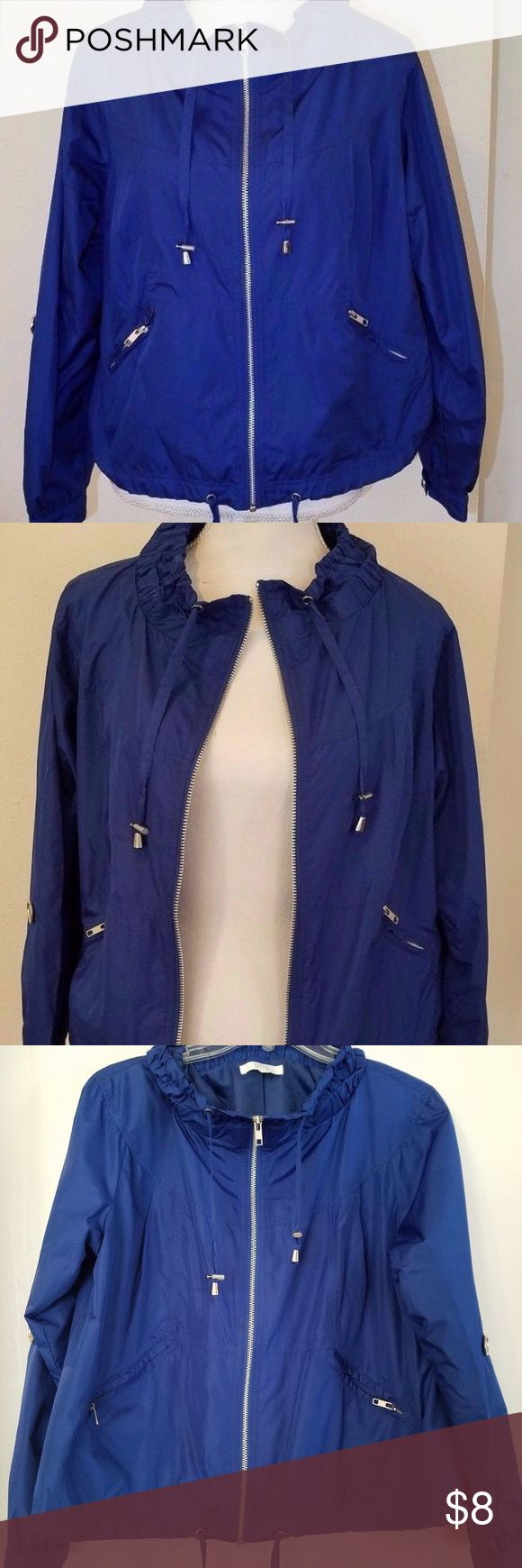 "Marks and spencer blue wind coat jacket size 8 Marks and Spencer size UK 10 (Medium) light weight blue jacket with zip up front with cowl neck.  Has a full lining. UK size 10=US size 8 2 zip up pockets on outside drawstrings on collar and bottom of jacket pre-owned good condition with a few barely noticable light spots on back (see pictures) arm (from top shoulder seem to cuff): 23"" Length (from front collar seem to bottom): 19"" Bust (underneath armpit): 21.25"" Marks & Spencer Jackets…"