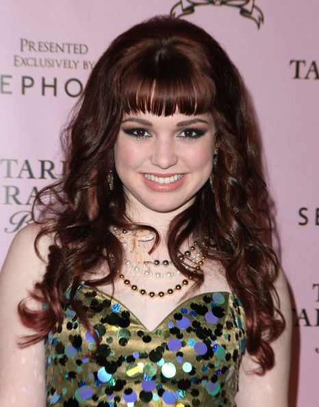 Jennifer Stone Lookbook: Jennifer Stone wearing Long Curls with Bangs (8 of 8). Amongst the many actresses Jennifer Stone showed off her curly long locks. Her face framing bangs were a nice way to keep her hair style from looking overly voluminous.