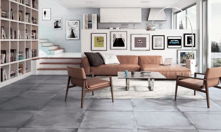 #designdrops * Inspiração: O cimento queimado também vem em forma de porcelanato, uma solução para se ter essa textura aplicada de uma forma mais simples. Nesta sala um contraste com as cores dos móveistrazemo conforto e calor equilibrando com a frieza do piso.
