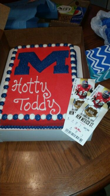 Here's a picture of the Ole Miss Rebel cake & Tickets