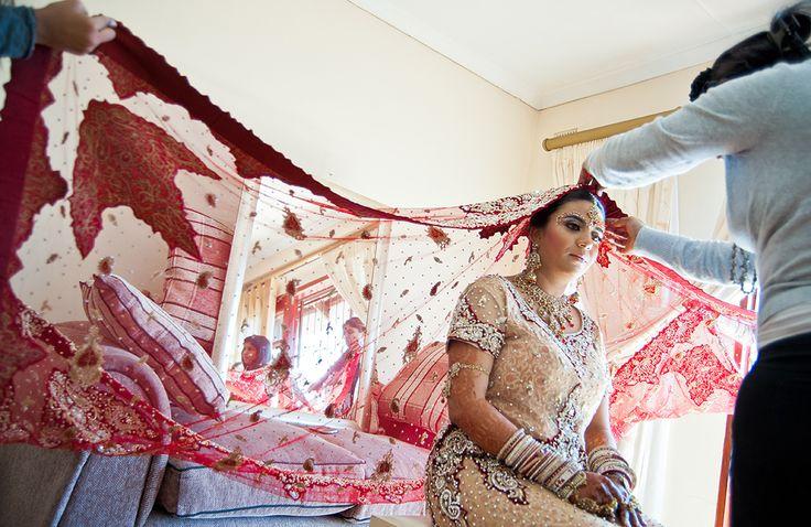 Hindi bride putting on veil
