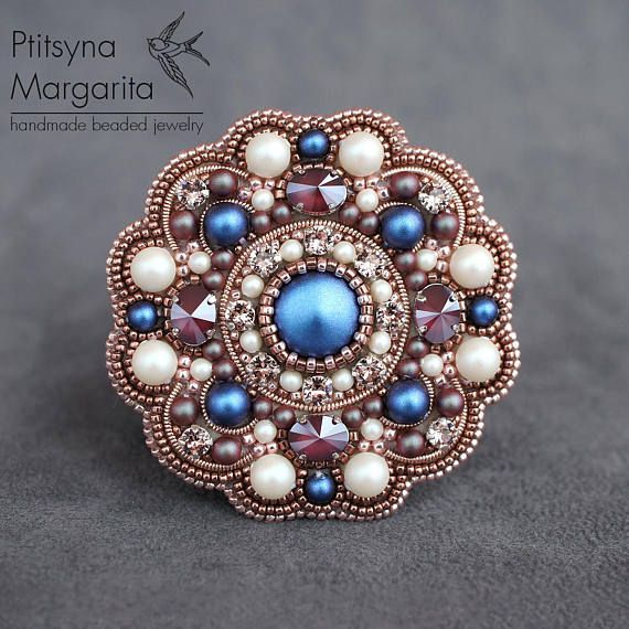 Bead embroidery brooch Kaleidoscope This order brooch is embroidered with Swarovski crystals and pearl, japanese seed beads and french wire. Backside is covered with faux leather. The brooch is made in unusual color combination - peach pink, dark pink, blue, red and white. Pearl is