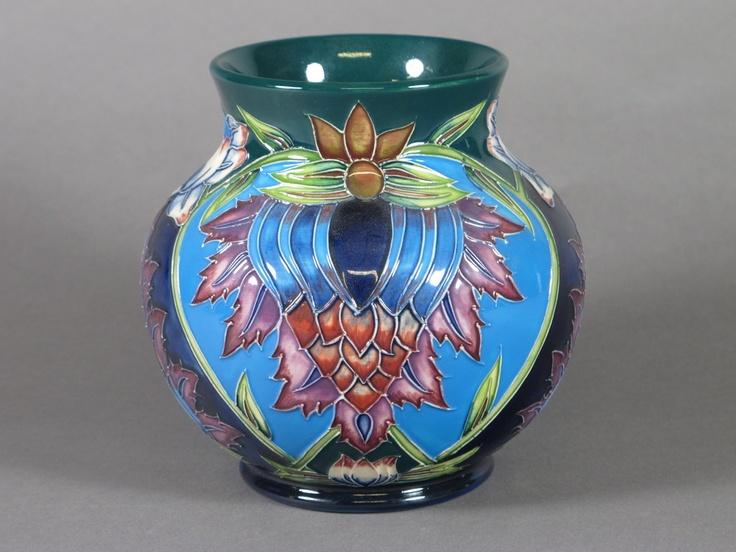 "A Moorcroft 2001 circular blue and floral patterned vase, the base marked KL 6"""