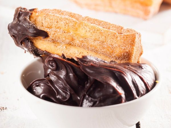 Deep-fried pastries that are moist and light in the inside and crunchy on the outside. As a bonus they're dipped in chocolate ganache – mmm! PHOTO: Jacques Stander