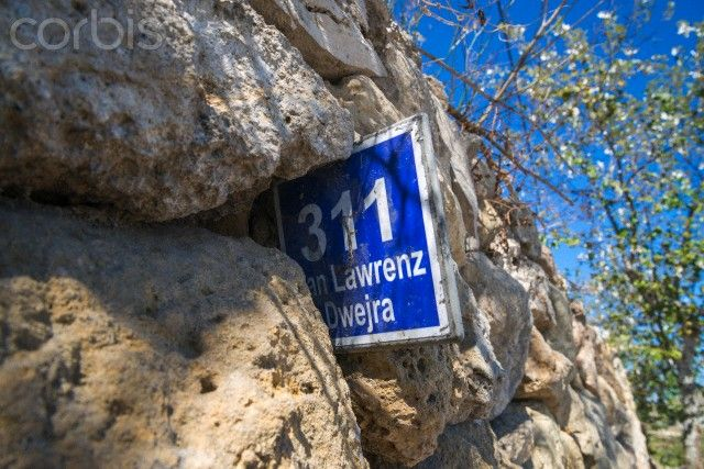 Ed Pritchard - Bus route marker in a dry stone wall, Gozo, Malta