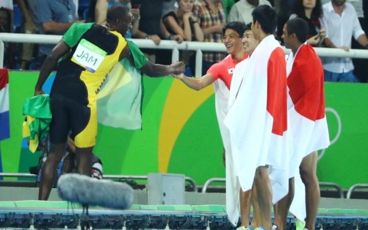 Bolt congratulates 2nd placed Japanese 4 x 100m Relay team finishing ahead of USA