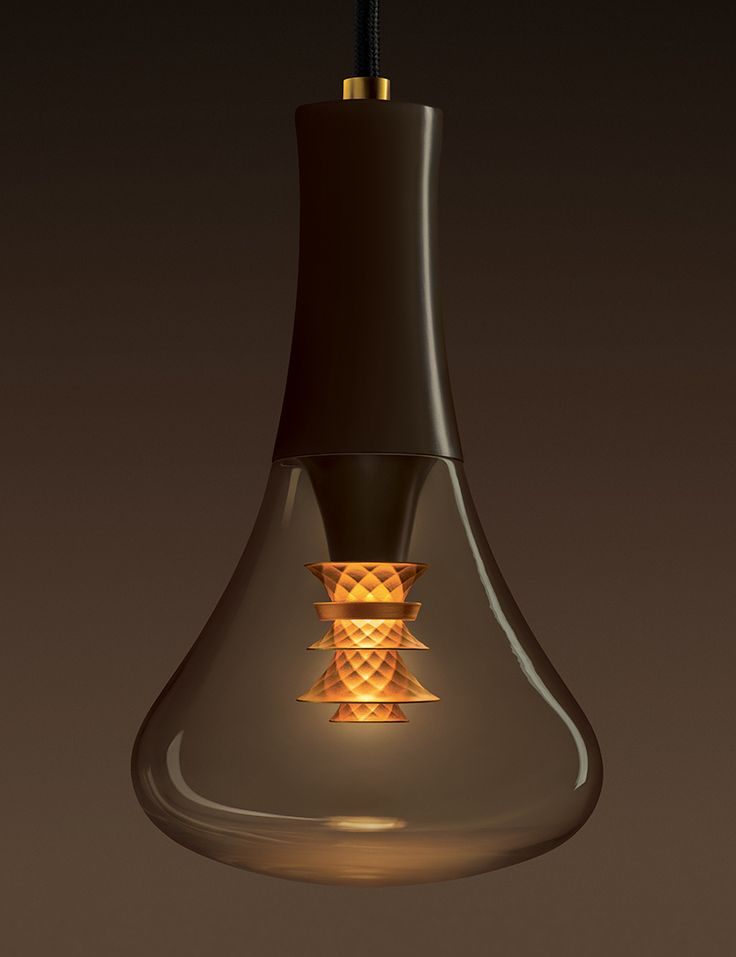 The bespoke, chocolate-brown pendant frames the bulb by covering the lamp…