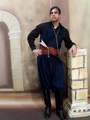 A Cretan, honoring the traditional dress of our forefathers...