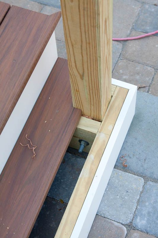 Newel post installation on a porch or deck - Bailey Carpentry