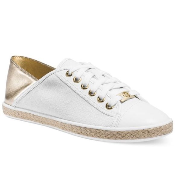 MK canvas sneakers gold back MK canvas sneakers gold back size 9. Worn just a few times great condition. No scuffs or marks. Price firm. Michael Kors Shoes Sneakers