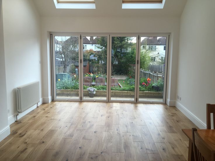 Stunning bifold door installation. Load bearing walls removed, space opened up and 12ft wide bifold door installed to flood the room with sun light.