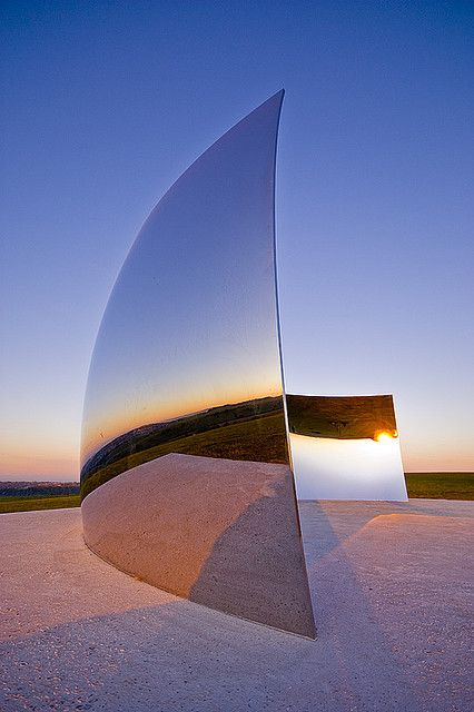 """C-Curve"" installation by Anish Kapoor at South Downs, Brighton, UK, 2009. Photo by Carl Abrams, via Flickr"