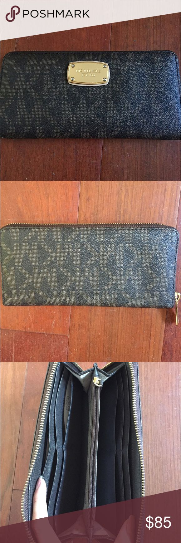 Authentic Michael Kors Continental Wallet Signature Jet Set item Zip Around Continental Wallet. Practically still like new! The name plate has a few scuffs as shown in the picture but overall almost in perfect condition! A good wallet that holds tons of things. Selling because I want a wallet in black instead to match my purse🙂 Michael Kors Bags Wallets
