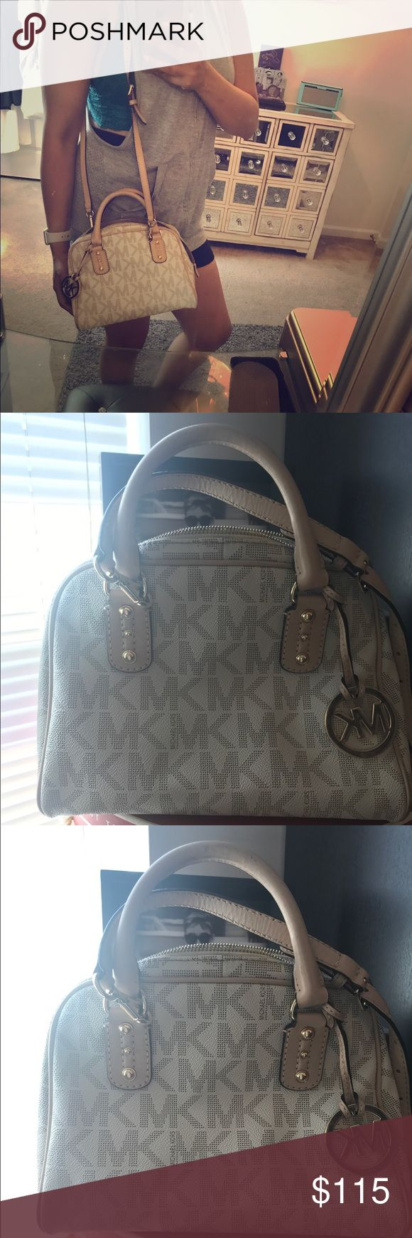 Michael Kors Handbag This is a beautiful off white  Michael Kors handbag. Perfect for a night out or casual weekend. When I purchased this bag I fell in love with it because it was so versatile. Small enough to carry anywhere but big enough to fit all my essentials. Hand bag was utilized but taken care of. Michael Kors Bags Crossbody Bags