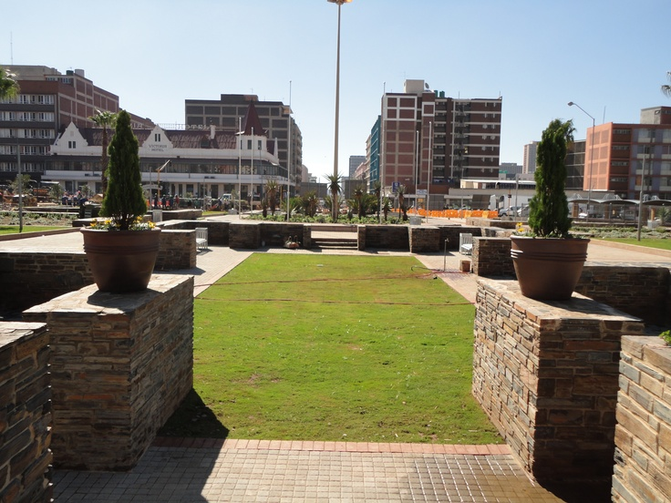 2010 - Pretoria Station Historical Forecourt restoration @ Pretoria Main Station and Gautrain station - View from historic sunken garden towards the Victoria Hotel and Church Square.  The lawn in the foreground used to a pond but due to maintenance, safety, use and cost issues it could not be restored.