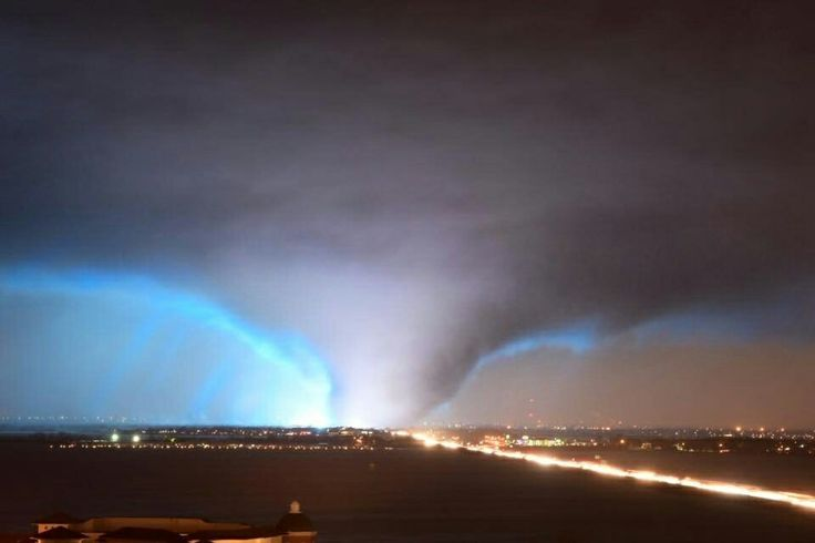 Remarkable photo of the large tornado that impacted Rowlett & Garland, Texas spring of 2016. The bright blue/white flash is an electrical discharge of a transformer or electricity hub that was in the path of the tornado and was damaged at the exact time this photo was taken. This was a night time tornado. Great photographic timing by this photographer.