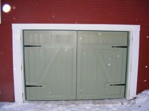 A Barn Style Door On An Old Farm House, With Not Only A Custom Design
