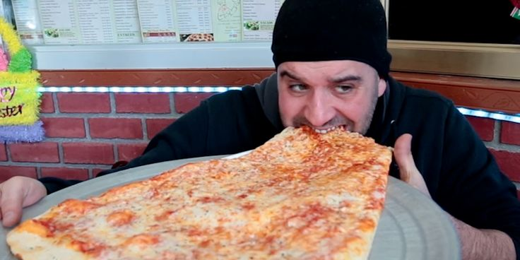 """Pizza Barn in Yonkers, New York serves up a two-foot """"super slice"""" of pizza — we went to see how it was made."""