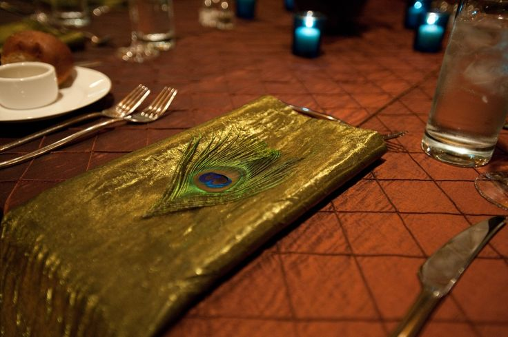 Beautiful Peacock inspired wedding. Love the contrast of the Moss green napkin against the Rust Pintuck