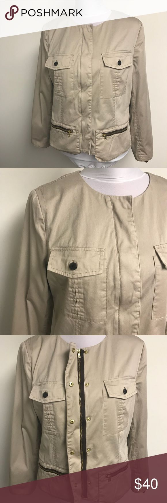 """CHICO'S Khaki Beige Casual Zip Up Cotton Jacket Collarless khaki beige casual jacket by Chico's. Chico's size 1 / US women's size medium.   Zip front with snap-close flap. Two front flap pockets and two zippered pockets. Polyester animal print lining.  Very good, gently worn condition.  Measurements Pit to Pit: 19"""" Sleeve (under): 16"""" Length (shoulder to hem): 22.5""""  Material: 98% cotton, 2% spandex.   Wash/care instructions: Machine wash cold Chico's Jackets & Coats"""