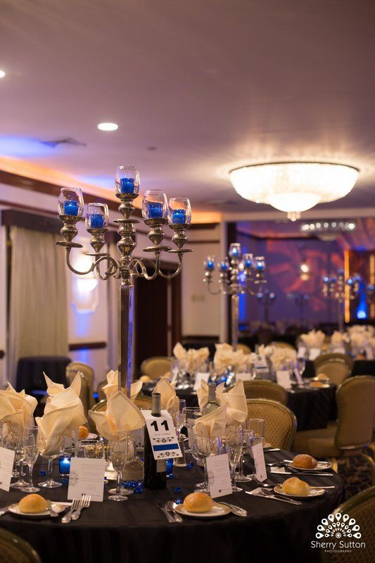 Large candelabra with blue candles as centerpiece Photo By Sherry Sutton Photography