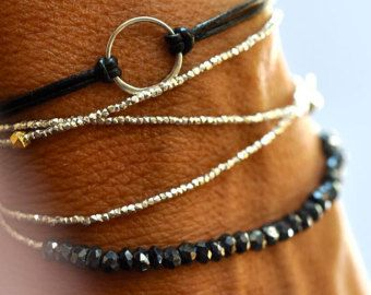 Here is the Baby Karma bracelet on wonderful soft black leather. What goes round - comes round! Great Unisex bracelet. If you need more than