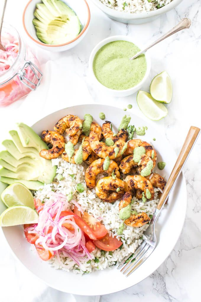 Peruvian Shrimp Bowls with coconut cilantro rice, salsa criolla (lime marinated onion + tomatoes), Mint Cilantro Sauce, and avocado! {GF}