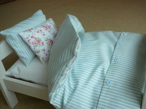 The bedding is made for an IKEA Duktig doll bed, which is 48cm by 30cm. It contains 8 pieces; a mattress, a duvet, a fitted sheet, a duvet cover and two pillows and two pillow cases (both of different size which can be seen in the photographs). It is based on actual beddings so the duvet set can be removed and washed. The set is made up of three different fabric designs: a plain ivory fitted sheet, a powder blue and white striped duvet cover and big pillow case and a small pillow case that…