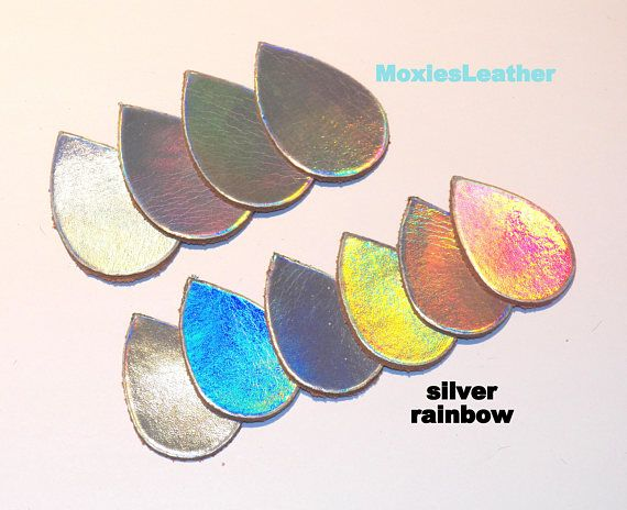 10 Leather pieces in sturdy silver rainbow iridescent leather. Reflects the colors of the rainbow when moved. Teardrop measures 1.5x2 inches  Leather pieces for earrings and jewellery projects. Machine cut for perfectly straight pieces.   Please convo us for wholesales prices for larger