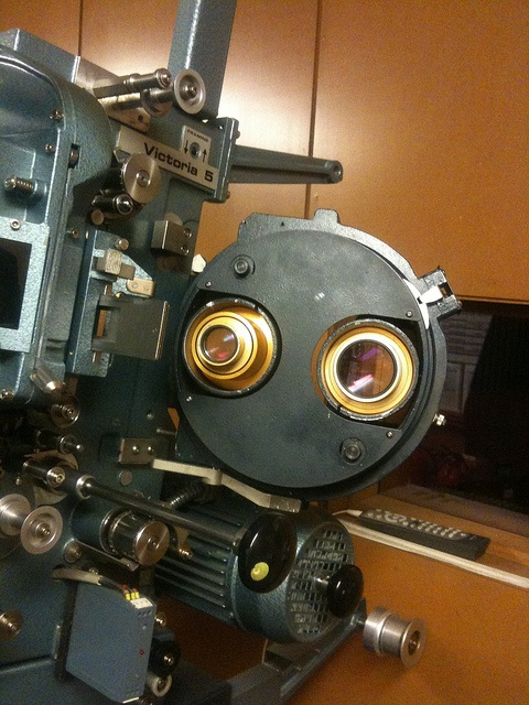 Two different lenses in 35mm film projector (Cinemeccanica Victoria 5) by Jodiepedia, via Flickr