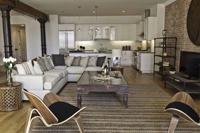 Living room sofa table flowers design coverlet lighting large room idea