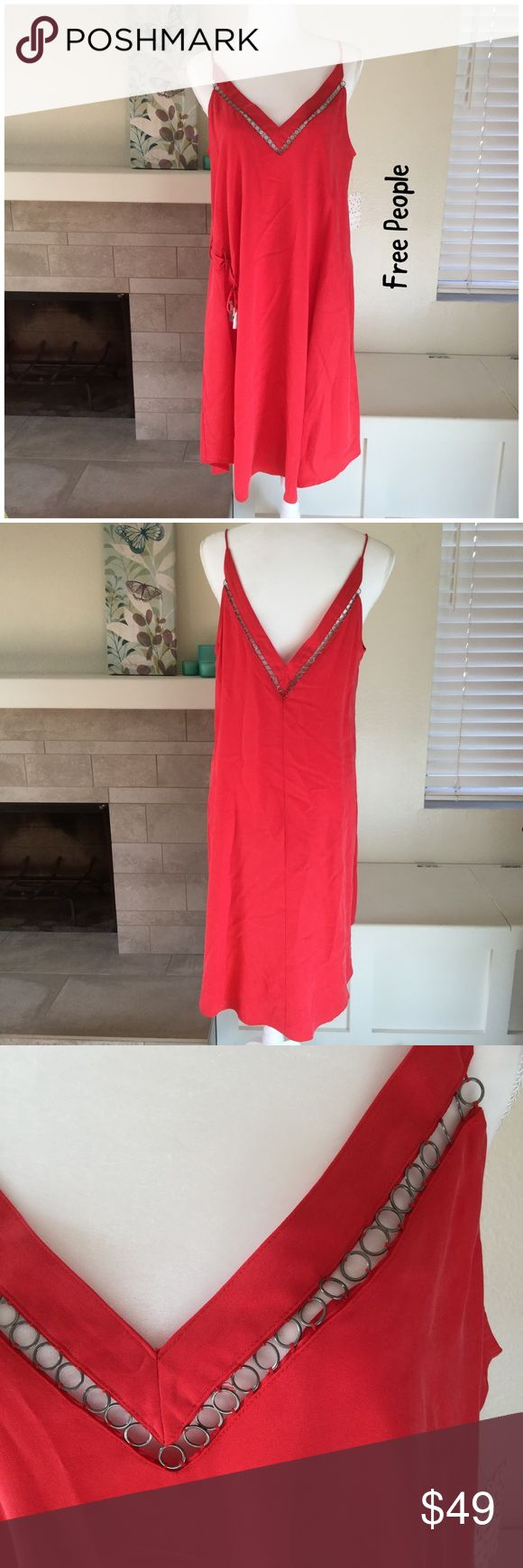 """🆕 NWT Free People All I Want red dress From festival to date night, this dress has you covered.  🐾 Red with grommets accents along neckline (front and back) 🐾 Side slit (right side) 🐾 Lace up side (ends still wrapped in tissue) 🐾 Spaghetti strap 🐾 V-neck front and back 🐾 Pullover style (no zippers) 🐾 Bust: 20"""" 🐾 Length: 42"""" 🐾 100% tencel 🐾 Machine wash, tumble dry 🐾 NWT  🐾 Bundle discount 🐾 No trades, no PP 🐾 Smoke free, pet friendly home Free People Dresses Midi"""
