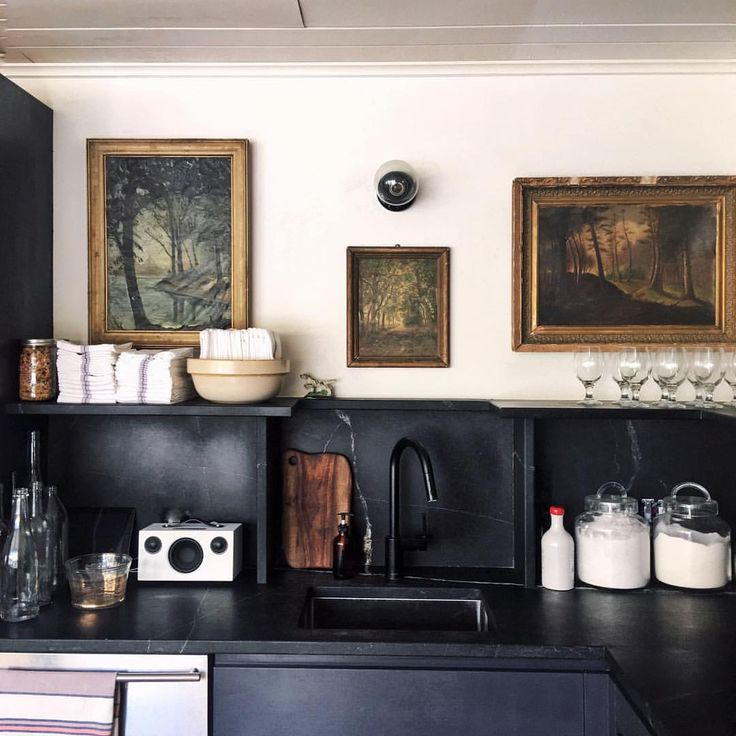 Antique oil paintings mixed with contemporary touches are among my favorite combinations. This kitchen I recently designed for…