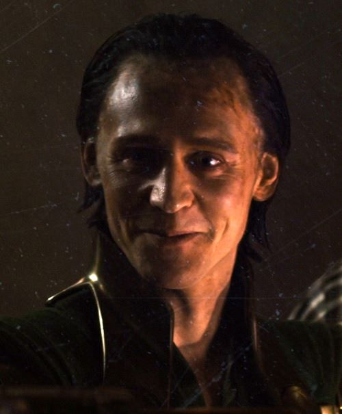 See the scorch marks on his forehead? These were made by Thanos after he had found Loki from his fall off the Bifrost. Thanos used him as a puppet to conjugate Earth, that way, Loki got the blame, not Thanos.  Loki never wanted to take over Earth. Notice how weak, sweaty, and sickly he looked once Loki first arrived to Earth? his sudden fall as he's walking out of the room with the Tesseract? He was suffering from heat exhaustion. How do you torture a frost giant? With heat.