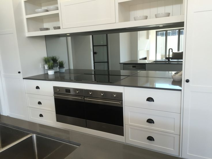 White kitchen, smoke grey mirror splashback By Verity Rhodes Interiors