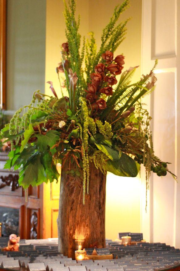 large tree stump flower holder. floral arrangement for rustic wedding