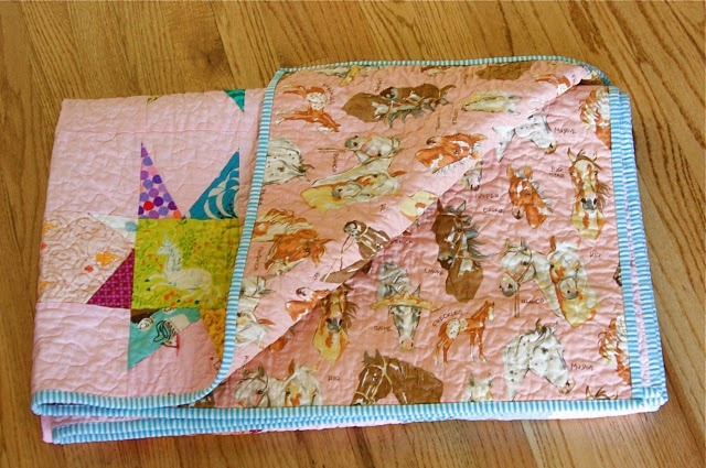 Love the backing (stable mates by alexander henry) and the binding!