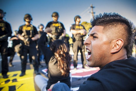 Police and students were at odds in front of Trevor G. Browne High School during a protest.  PHOTO BY: JACK KURTZ/THE ARIZONA REPUBLIC