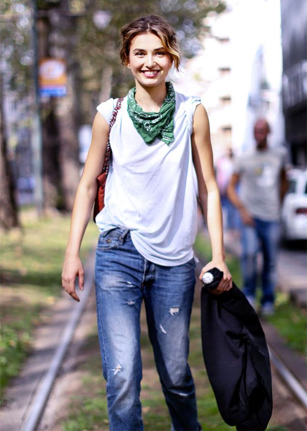 Love this easy, off-duty outfit idea: distressed jeans, half-tucked white muscle t-shirt, and bandana at the neck