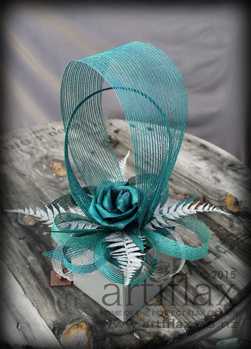Teal, turquoise and silver flax flower centrepiece by Artiflax