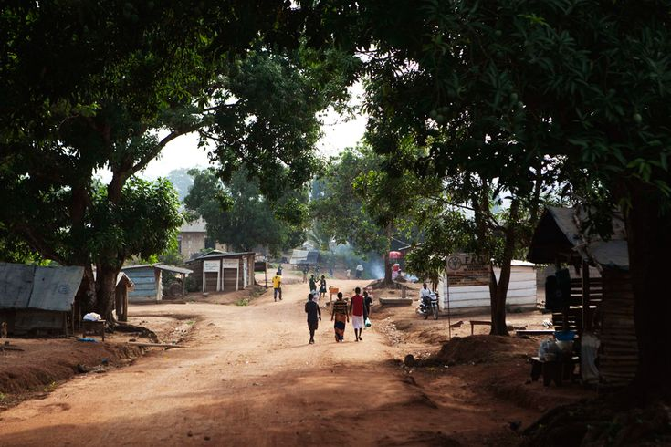 People walk through the town of Kailahun in eastern Sierra Leone. Sierra Leone's 11-year conflict from 1991-2002 left over 50,000 dead and became a byword for gratuitous violence, especially the amputation of limbs. A decade later, the West African nation is peaceful, but among the world's poorest. It is due to hold elections in November. April 23, 2012.