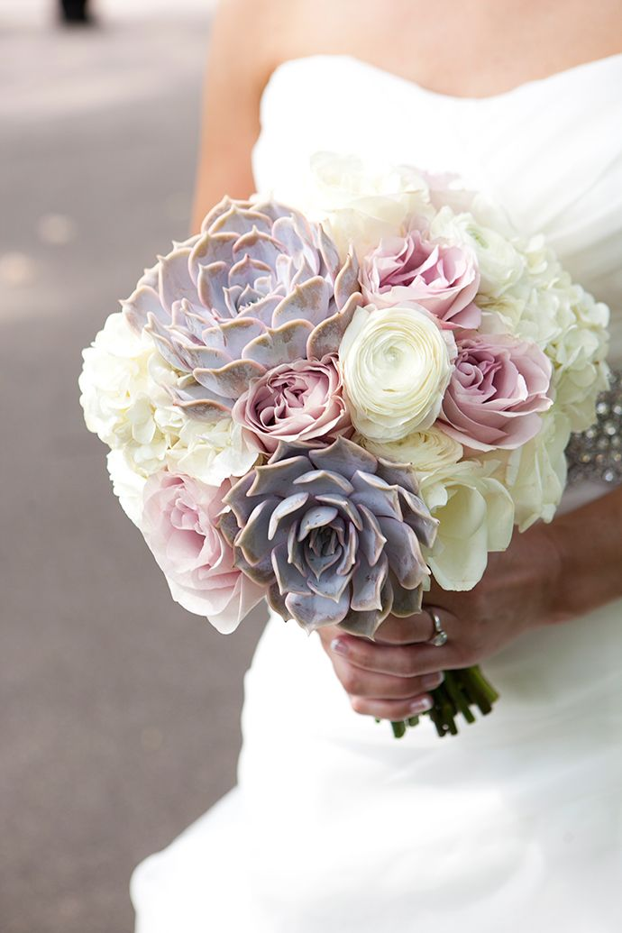 Beautiful bridal bouquet of soft roses, ranunculus and succulents. Love!