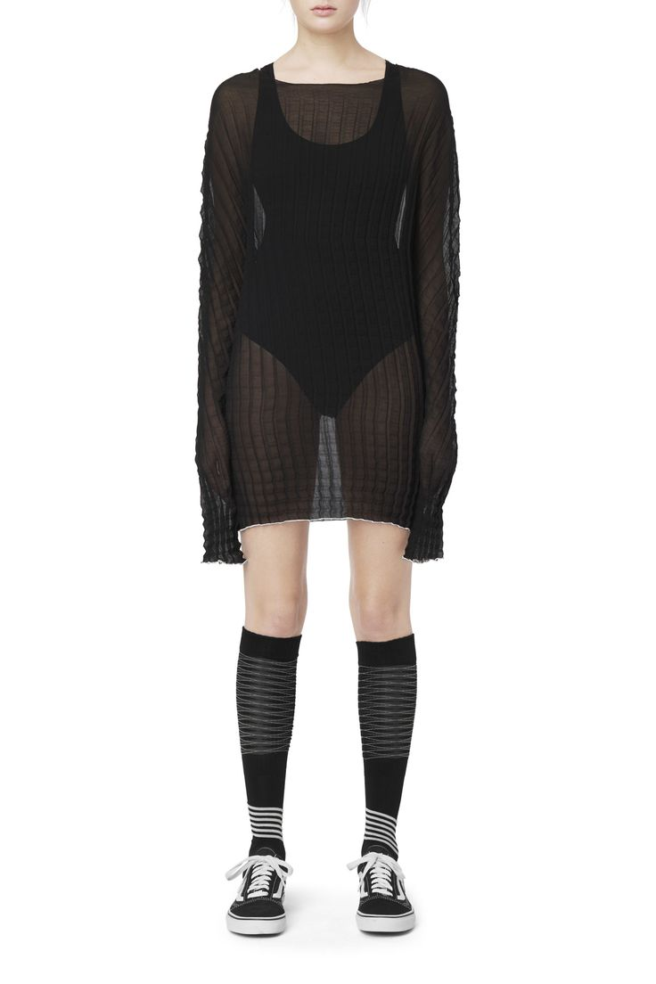 <p>The Enmity Dress by Haal plays with a refined plissé texture of a delicate sheer material. Its voluminous sleeves, ring neck and a contrasting hemline co