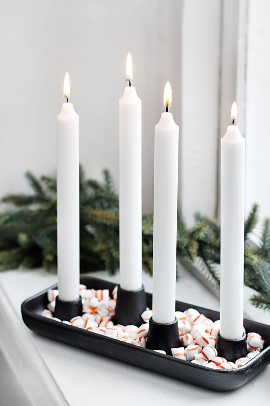 Advent...displaying the four Sundays. You can substitute the 3rd candle for a pink one. Sometimes it is called Mary's candle.
