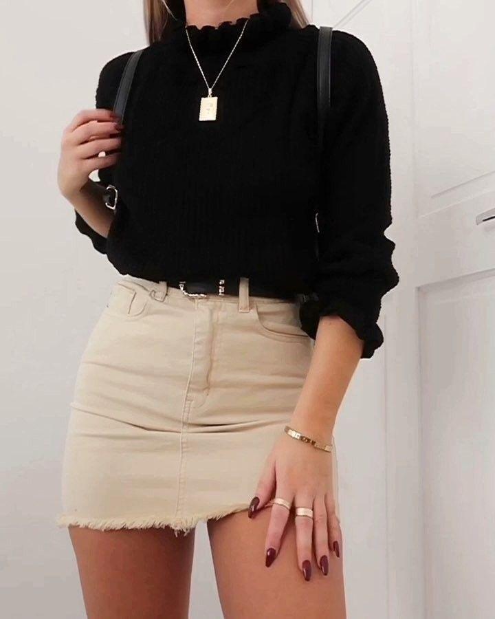 Schwarzer Pullover und Rock Outfit