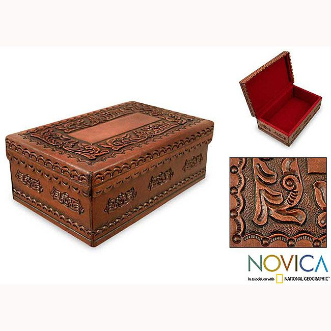 Box inspired by the time of Spaniard Felix Lope de Vega. Handcrafted moena wood accent piece is covered with lavish motifs in tooled leather. Decorative accessory includes a velvet lining to protect your keepsakes.