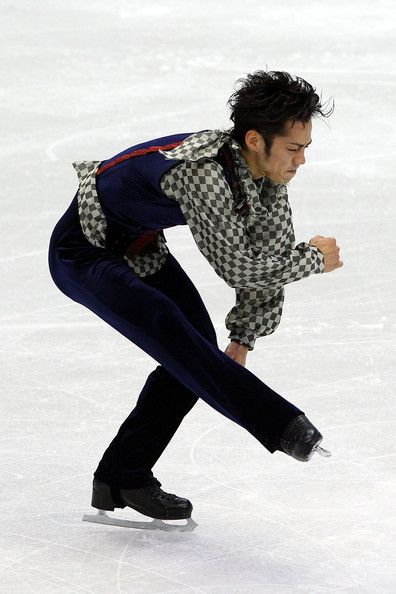 Daisuke Takahashi Photos Photos - Daisuke Takahashi of Japan competes in the men's figure skating free skating on day 7 of the Vancouver 2010 Winter Olympics at the Pacific Coliseum on February 18, 2010 in Vancouver, Canada. - Figure Skating - Day 7