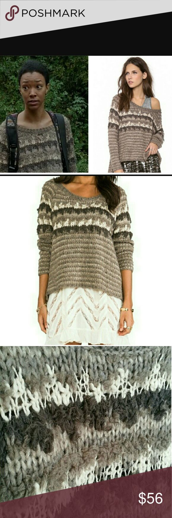 """Free People Fair Isle Chunky Knit Sweater As seen on Walking Dead!  Free People Fair Isle Chunky Knit Sweater This beautiful sweater was worn once, no flaws on sweater! The tag has a small hole from pin, ( shown on pictures) otherwise flawless! Very soft, chunky knit fair isle print. Oversized fit. Material 53% acrylic, 26% wool, 9% cotton. Armpit to armpit 23"""", neck to hem 16"""", neck to back panel hem 23"""", sleeve length 18"""" Sweaters Crew & Scoop Necks"""